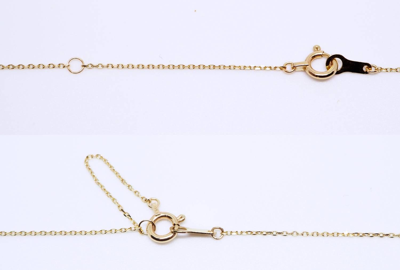 5cmのところにアジャスター環つき。このようにして使います。ちょっぴり短く使いたいときに。